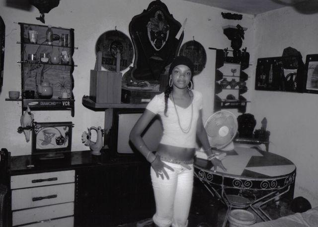 HAVANA, young girl in a room filled with 'Santeria' symbols